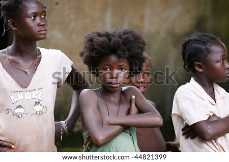 BURKINA FASO - AUGUST 12: Girls of the Lobi ethnic group, the Lobi maintain their ancestral customs, hardworking women and men protecting the village, August 12, 2009 in Gaoua, Burkina Faso