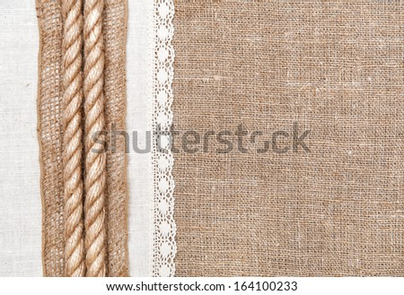 Burlap background, rope and linen cloth with lace
