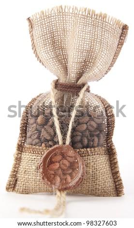 burlap bag tagged sealing wax with cofee bean
