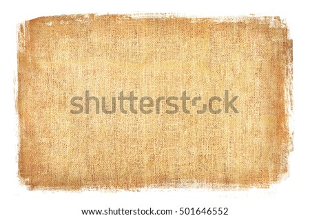 Burlap rough fabric background with a white frame edge. Textured brown material with stained and frayed edges.
