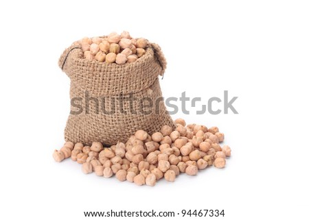 Burlap sack with chickpeas spilling out over a white background. Soft shadow