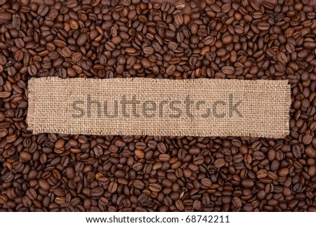 Burlap tag on the background of coffee