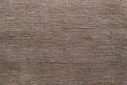 Burlap texture. Coarse weave for sewing bags. Patterns and backgrounds. Coarse weave material