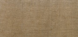 Burlap texture. Sackcloth rustic canvas background. Large piece of rough fabric woven of flax, jute or hemp. Design element. Top view.