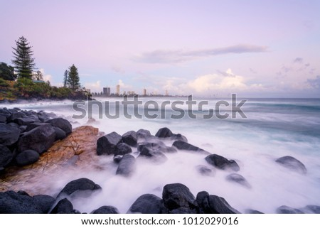 Burleigh cove during a pastel sunrise on the Gold Coast. Burleigh Heads, Gold Coast, Queensland, Australia.