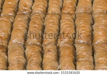 Burma baklava, turkish dessert sweet and traditional authentic specialty, baklava roll form, walnut, honey and nuts filling, shape, similar to burma. Sarailie, baclava