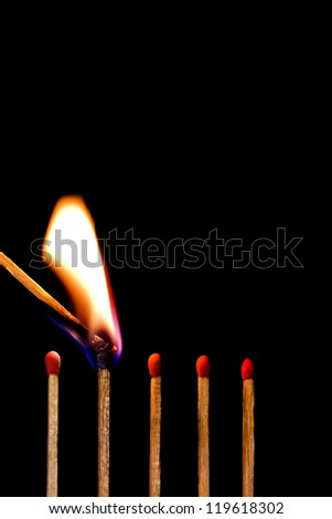 burn a row of matches on black background