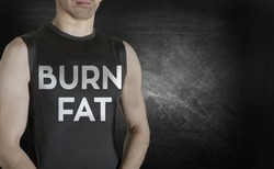 Burn fat. Conceptual image of healthy life. Caucasian male fit model on black background.