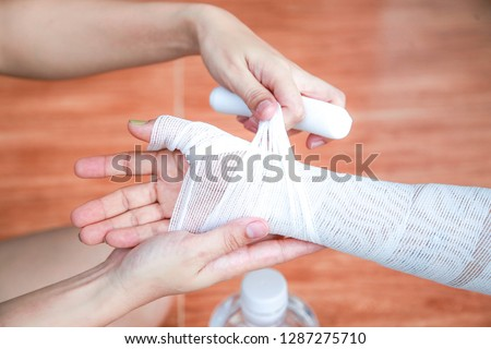 Burn from hot oil splashed on the arms and legs And wound by sterilizing and closing with a bandage.