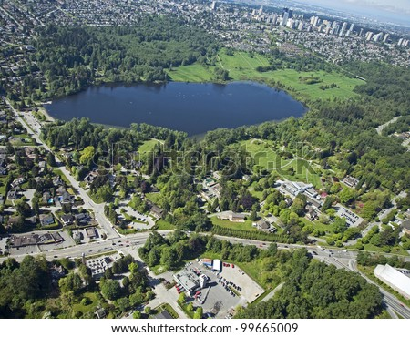 Burnaby Aerial - Deer Lake Park with lake and homes in Burnaby