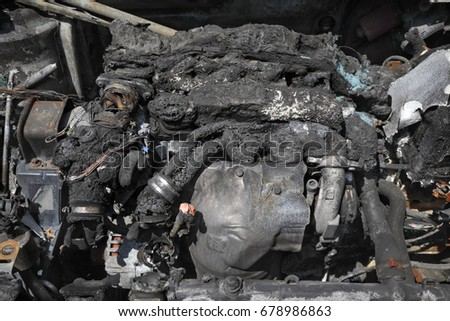 Stock Photo Burned and damaged car engine after fire accident