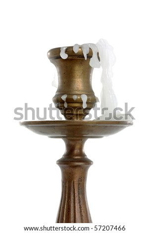 burned candle in an antique candlestick isolated on white background