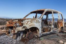 burned car abandoned, car destroyed bo fire, mini van