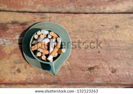 burned cigarettes is in ashtray