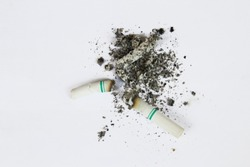 burned cigarettes on white background