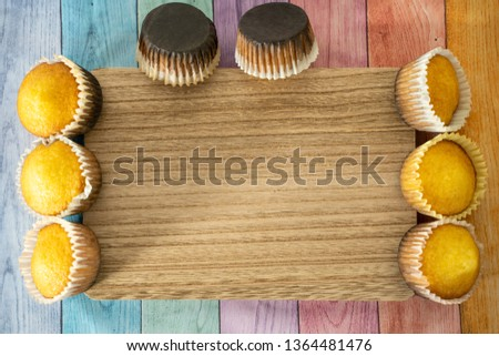 Burned homemade cornbread muffins on a pastel wood background, room for copy. Concept for baking mishaps, mistakes #1364481476