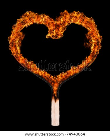 Burned match in shape of heart on black background