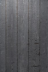Burned natural wood plank panel texture in high resolution / black wood / background texture