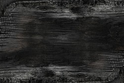 Burned noisy scratched hardwood surface. BBQ background. Burnt wooden Board texture.  Smoking wood plank background. Burned wooden grunge texture.