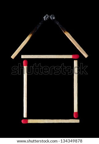 Burned roof of matchstick house - stock photo