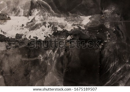 burned wall texture, grunge wall, black and white grunge background, rough black burned concrete wall background with whitewash scratche stock photo