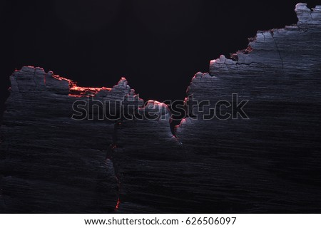 Burned wood texture, burning edges. macro. stock photo
