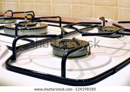 burners on the gas stove in the kitchen