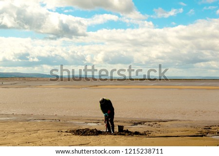 Burnham on sea  fisherman digging for bait #1215238711