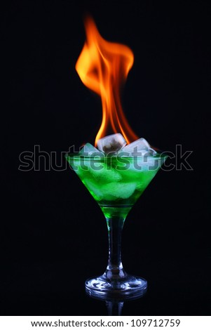 Burning a cocktail with absinthe