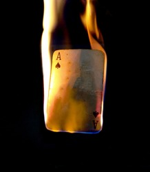 Burning Ace of spades. Ace has the highest card value in a deck of card and the fire depicts it's power and superiority. The picture can be used for background or wallpaper or logo making.