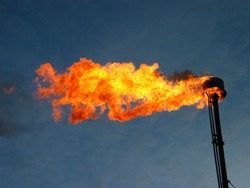 Burning and smoking oil flare
