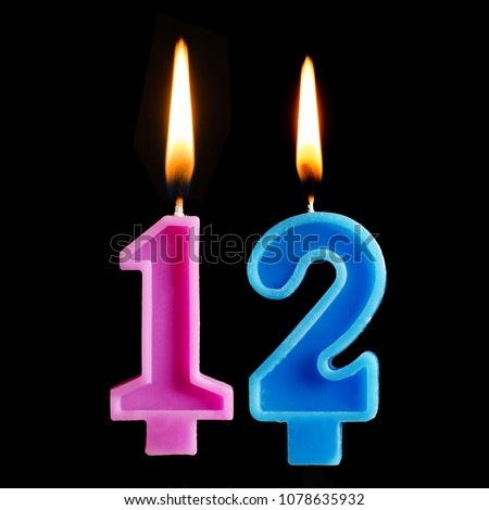 Burning Birthday Candles In The Form Of 12 Twelve Figures For Cake Isolated On Black Background