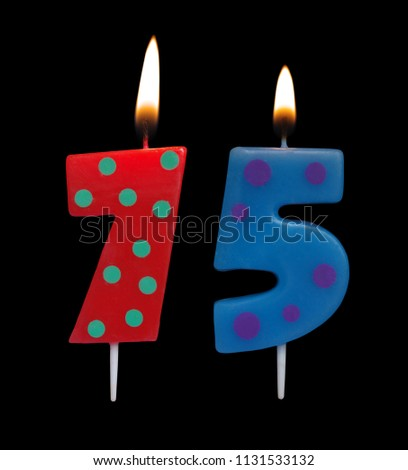 Burning Birthday Candles On Black Background Number 75 1131533132