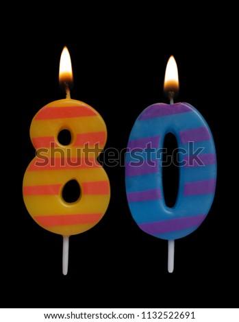 Burning Birthday Candles On Black Background Number 80 1132522691