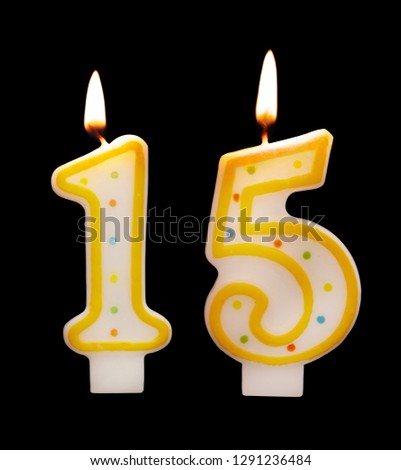Burning Birthday Candles On Black Background Number 15 1291236484