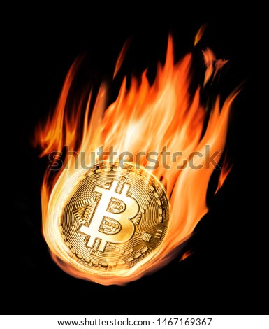 Burning bitcoin in flames on black background. Conceptual picture.