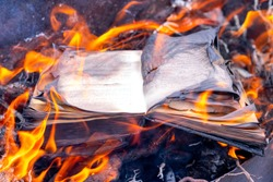 Burning book. The book is on fire. Burning unnecessary books