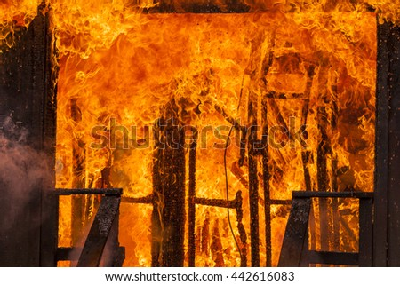 Burning Building Fully Engulfed in Flames