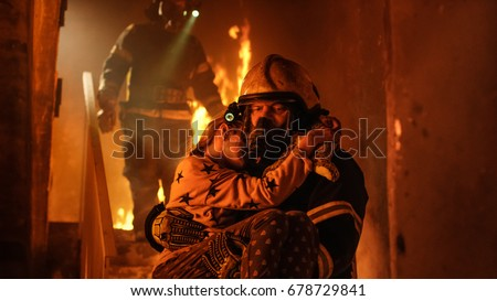 Shutterstock Burning Building. Group Of Firemen Descend on Burning Stairs. On foreground one Fireman Holds Saved Girl in His Arms.