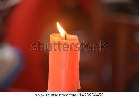 burning candle colorful candle on plain background #1423956458