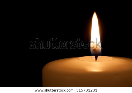 Burning candle in the dark with free copy space