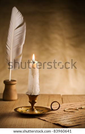 burning candle in vintage candlestick - stock photo