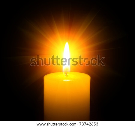 burning candle on a black background