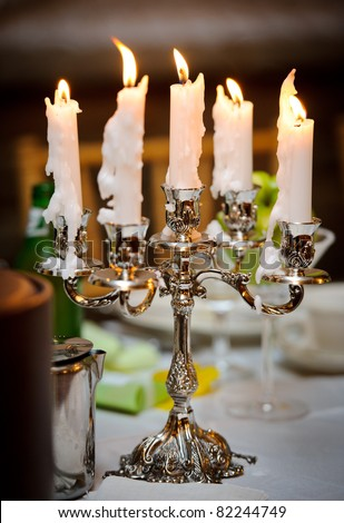 Burning candles at the wedding reception