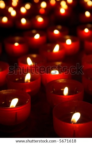 Burning candles for promise payment in catholic church - stock photo