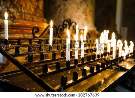 Burning candles in a church