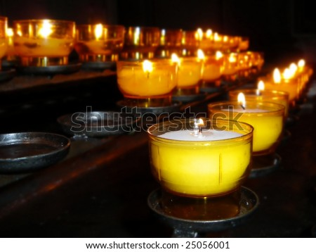 Burning candles in a church for worship.