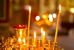 burning candles in an Orthodox church