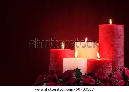 Burning candles in Christmas setting