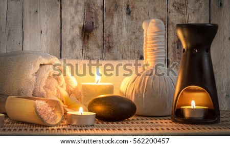burning candles in spa wellness #562200457